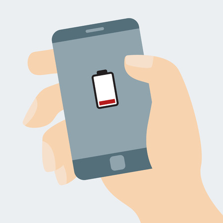 Hand holding smart phone running out of charge. Low battery icon