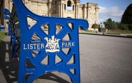 Lister Park bench with Bradford Council crest and insignia outside Cartwright Hall Museum and Art Gallery