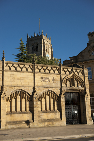 View of Bradford Cathedral from Forster Square showing the main tower against blue sky. September, 2013