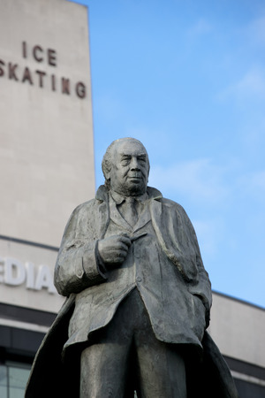Statue of JB Priestley (born in the city), author or An Inspector Calls outside the entrance to the National Media Museum in Bradford, Yorkshire, UK. Taken 10-10-13