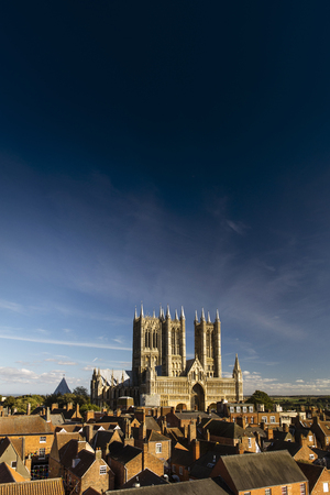 West Front of Lincoln Cathedral over rooftops with lots of sky room, Lincoln, Lincolnshire, United Kingdom - September 2016