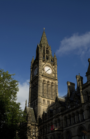 Manchester Town Hall in Albert Square against a blue sky. Manchester, UK - 29th October 2013 Stock Photo
