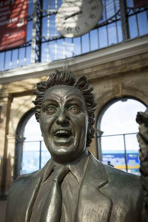 Ken Dodd Statue on the concourse of Liverpool Lime Street Railway Station, Liverpool, UK by sculptor Tom Murphy. 24th June 2014