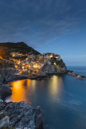 A view of the Cinque Terre village Manarola at dusk in La Spezia, Liguria, Italy - 16th May 2016