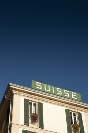 An old fashioned hotel sign for the Hotel Suisse in Bellagio, Lake Como, Italy, 27th August 2011
