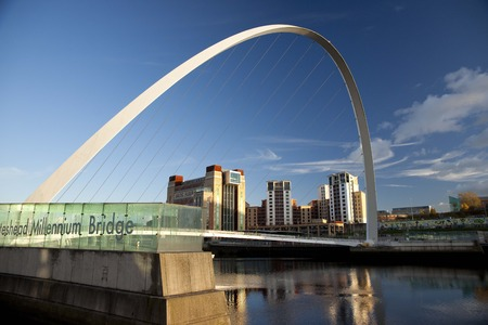 View of the Gateshead Millenium Bridge with the Baltic Contemporary Art Gallery building  in the background - Newcastle and Gateshead, UK - 5th November 2012