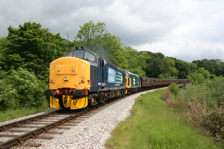 Class 37 locomotives numbers 37682 and 37025 approaching Mytholmes, Keighley and Worth Valley Railway, West Yorkshire, UK - June 2009
