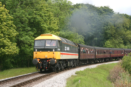 Class 47 47643 in ScotRail livery approaching Mytholmes at the Keighley and Worth Valley Railway, West Yorkshire, UK - June 2009 Editorial
