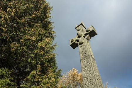 Tissington, Derbyshire, UK: October 2018: Saint Marys Church ancient cross