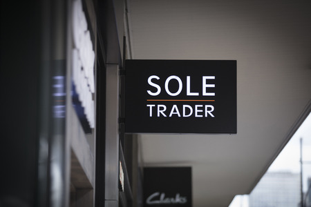 London, Greater London, United Kingdom, 7th February 2018, A sign and logo for sole trader store