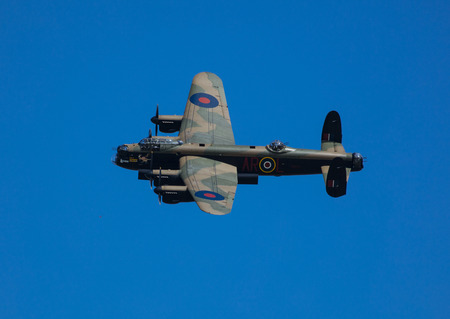 Avro Lancaster Bomber PA474 of the Battle of Britain Memorial Flight over RAF Coningsby, Lincolnshire, UK in the markings of 460 (RAAF) Squadron Lancaster W5005, coded AR-L and 50 Squadron code letters VN-T Redactioneel