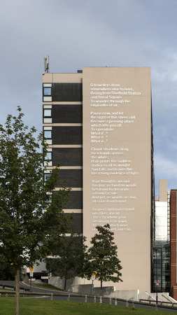 Poet Laureate Andrew Motions poem What If? on the side of the Owen Building at Sheffield Hallam University, Sheffield, UK - September 2013