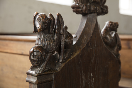 Thurgarton, Norfolk, UK, December 2016, Medieval Pew bench end carvings in Thurgarton All Saints Church Editorial