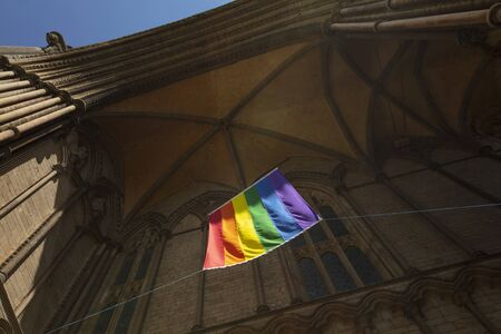 Peterborough, Cambridgeshire, United Kingdom, July 2019, A view of a Pride flag hanging from Peterborough Cathedral Éditoriale