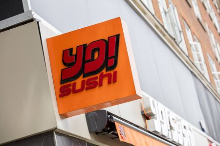 London, United Kingdom, 17th July 2019, Yo! Sushi Sign in central london Editorial