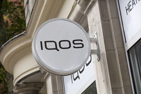 London, United Kingdom, 17th July 2019, Iqos Sign  in central london Editorial