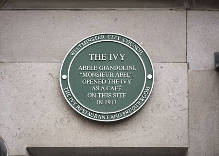 London, United Kingdom, 17th July 2019, Green plaque to mark the founding of the Ivy restaurant Stok Fotoğraf - 129508991