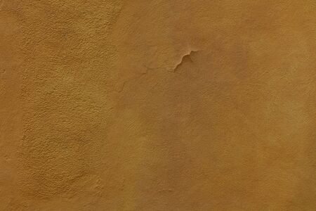 Yellow Ochre Textured Rendered Wall - Stucco  Fresco effect with small ripples and chips Stok Fotoğraf
