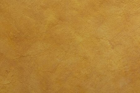yellow ochre Textured Rendered Wall - Stucco / Fresco effect with small ripples and chips Stok Fotoğraf - 131729992