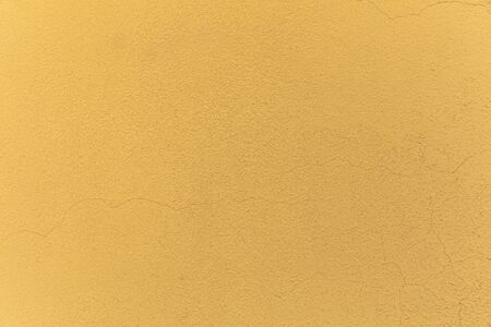 yellow Textured Rendered Wall - Stucco  Fresco effect with small ripples and chips