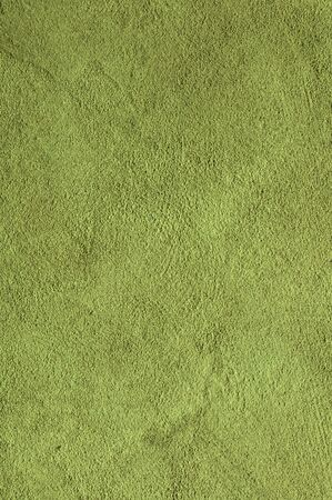 Lime green Textured Rendered Wall - Stucco / Fresco effect with small ripples and chips