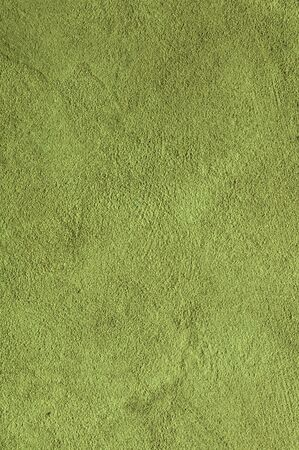 Lime green Textured Rendered Wall - Stucco  Fresco effect with small ripples and chips