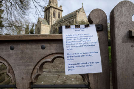 Colston Basset, Nottinghamshire, UK, 21st March 2020, Saint Johns Church with Covid 19 Coronavirus closure sign