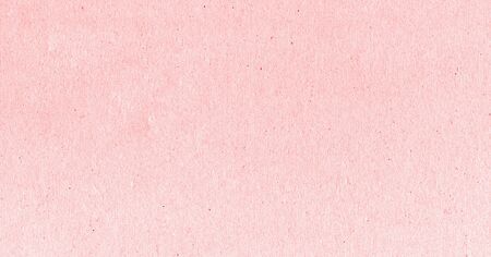 A fibrous card background with lots of texture in pink