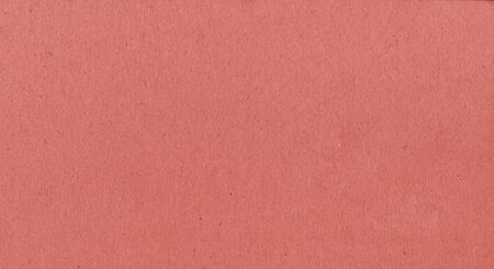A fibrous card background with lots of texture in red