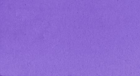 A fibrous card background with lots of texture in purple
