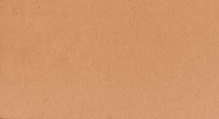 A fibrous card background with lots of texture in orange