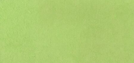 A fibrous paper with lots of texture in lime green