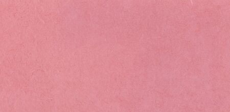 A fibrous paper with lots of texture in pink