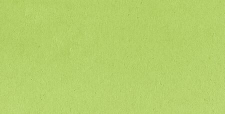 A fibrous card background with lots of texture in lime