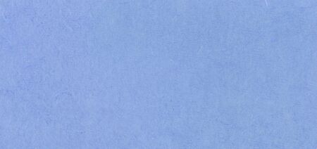 A fibrous paper with lots of texture in blue
