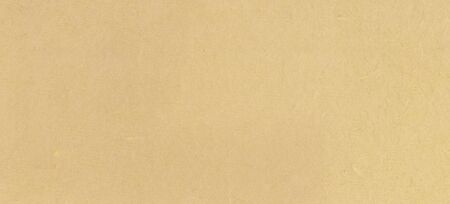 A fibrous paper with lots of texture in beige