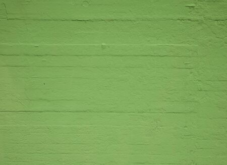 Textured concrete wall painted green