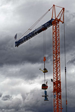 construction machinery: construction machinery hanging on a crane Editorial