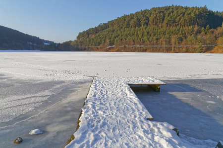 landing stage: landing stage on a frozen lake in the sun Stock Photo