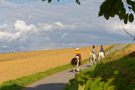 horseriding in german countryside Stock Photo