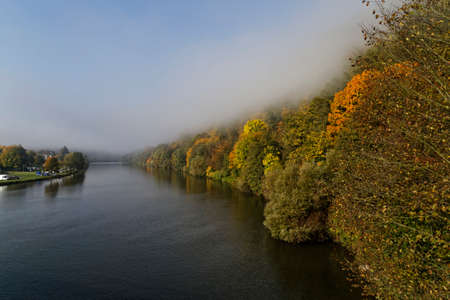 morning fog over the river Neckar in autumn