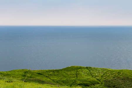 ocean and green grass Stock fotó
