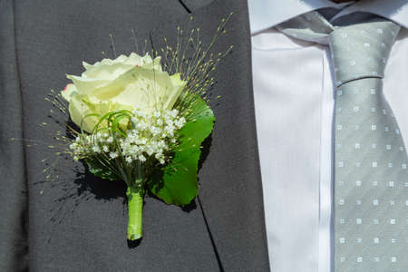 Grooms suit with rose
