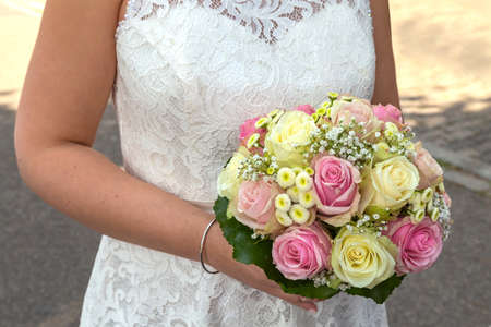 Bride holding flower bouquet 스톡 콘텐츠