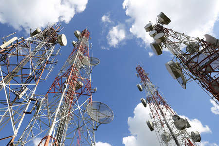 phone receiver: Telecommunication tower with blue sky and cloud Stock Photo