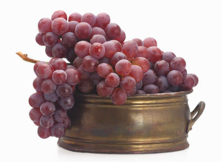 brassy: fresh red grape old  brassy tub isolated Stock Photo