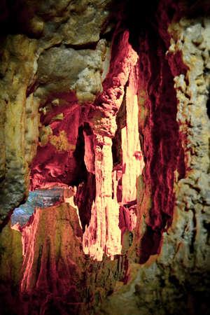 Stalagmite illuminated in pink in Neptune's Caves - Alghero (Sardinia)