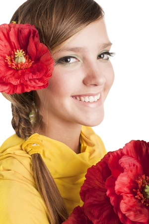 beautiful girl with red flower on her head are looking at the camera photo