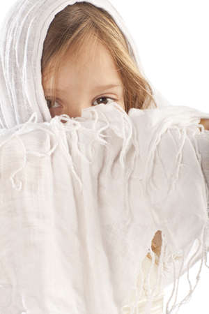small girl closes her face a white cape Stock Photo - 12759049