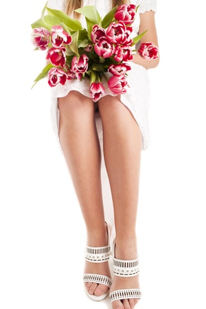 Woman legs in white shoes with flowers isolated on a white stock stock photo woman legs in white shoes with flowers isolated on a white mightylinksfo